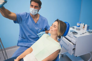 doctor prepares a patient for a root canal