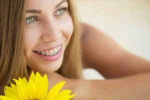a woman is thankful for orthodontics services